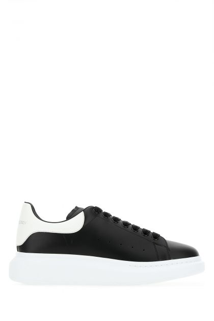 Black leather sneakers with white leather heel