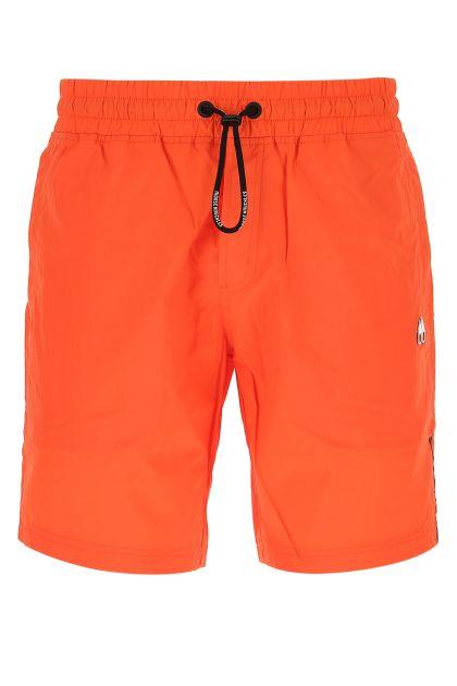 Orange nylon swimming shorts