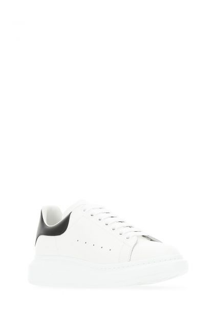White leather sneakers with black leather heel