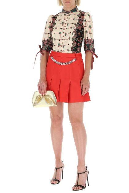 Coral gabardine mini skirt