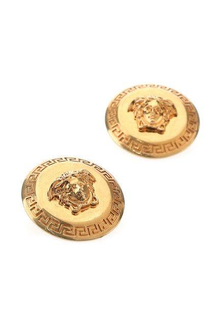 Gold metal earrings