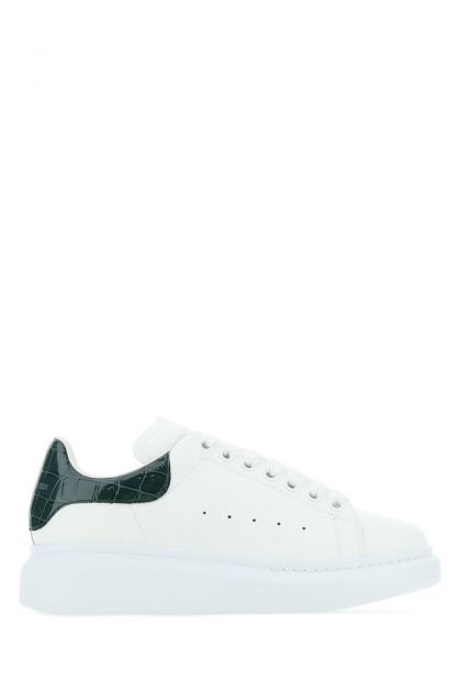 White leather sneakers with bottle green leather heel