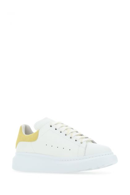 White leather sneakers with yellow suede heel