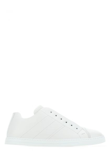 White leather slip ons